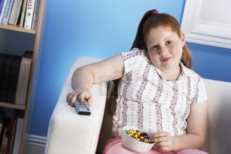 Overweight girl with remote control