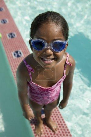 Girl in Goggles on Swimming Pool