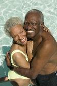 Couple hugging in swimming pool