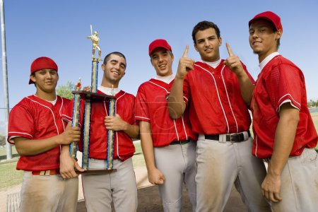 Baseball team with trophy on field