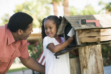 Father and Daughter checking mail