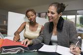 Women examining fabric swatches
