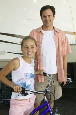 Father with Daughter on Bike