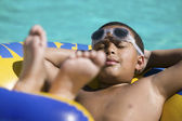 Boy Relaxing in swimming pool
