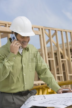 Construction worker with cellphone