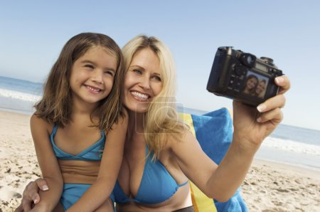 Girl and Mother Taking Picture