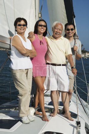 Family smiling on Sailboat