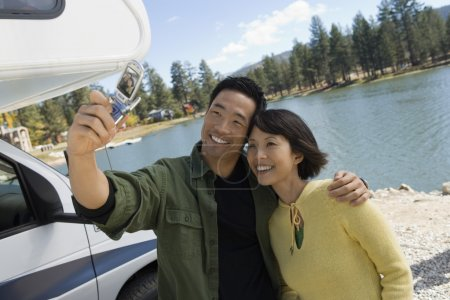 Couple taking picture of selves