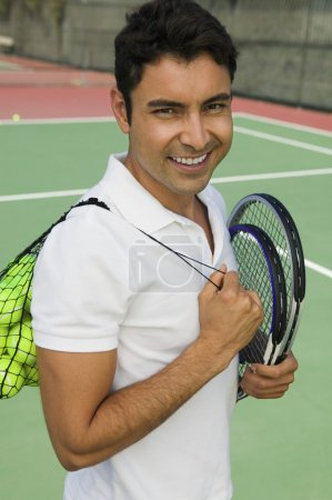 Man with tennis racket and balls