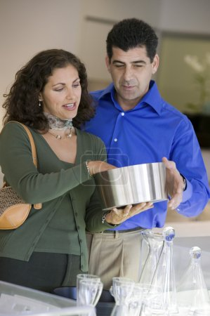 Couple Looking at Kitchenware