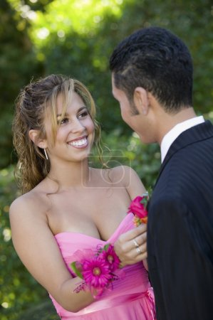 Girl Pinning Boutonniere on Date