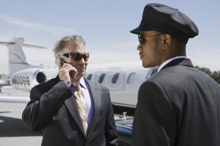 Businessman on call with private jet