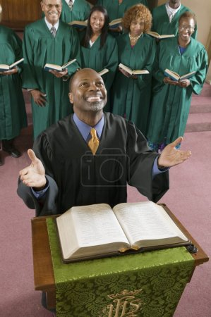 Happy preacher with Bible