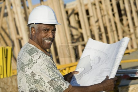 Man holding blueprint
