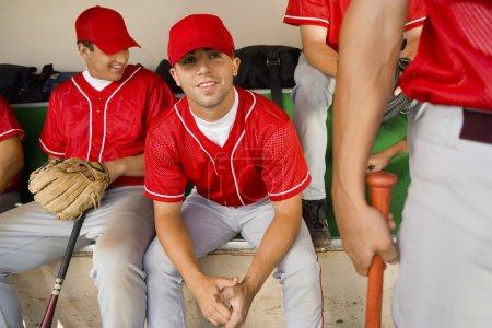 Baseball team-mates in dugout