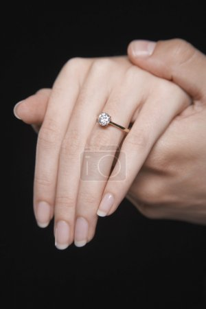 Woman's hand displaying engagement ring
