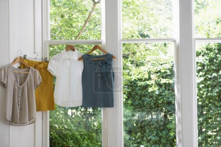 blouses and skirt on hangers