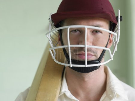 Cricket player wearing helmet