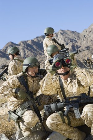 Photo for Group of soldiers with rifles and binocular patrolling during war - Royalty Free Image