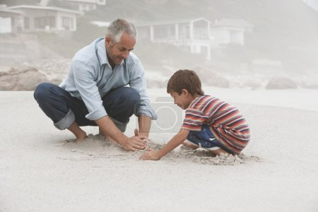 Father and son making sand castle