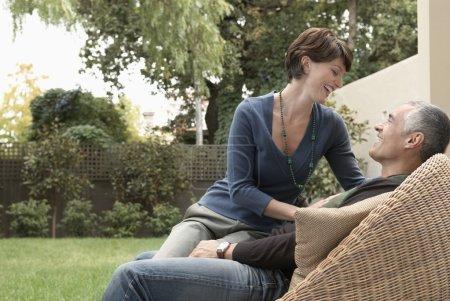 Woman sitting on husband's laps