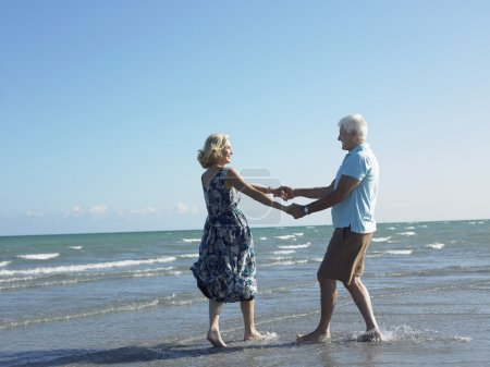 Senior couple dancing on tropical beach