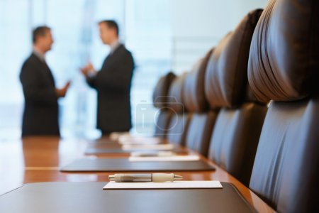 Photo for Businessmen talking in conference room - Royalty Free Image