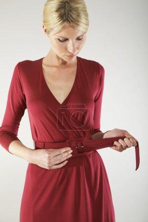 Woman Adjusting Belt