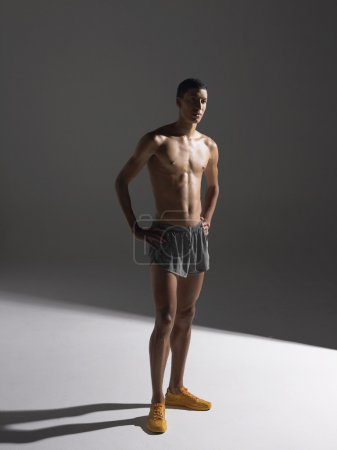 Photo for Shirtless athlete standing - Royalty Free Image
