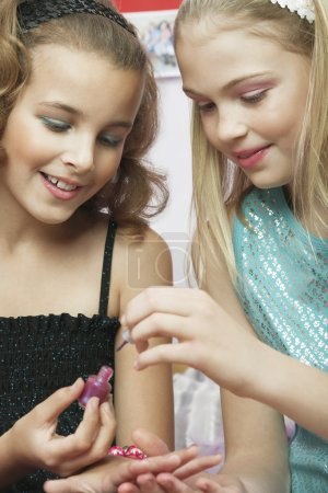 little girls applying nail polish