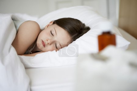 Little girl with cold in bed