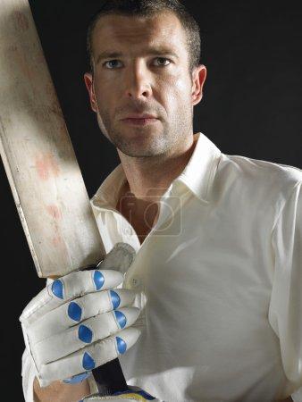 Cricket player holding cricket bat
