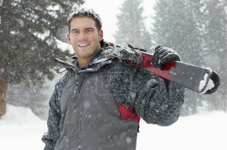 Man holding skis