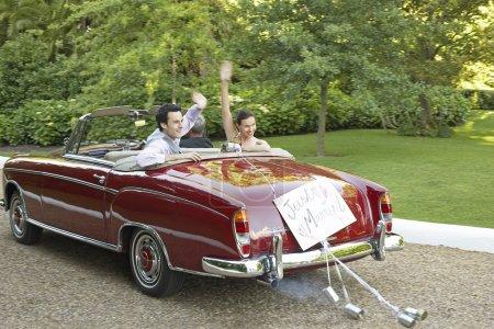 Newlyweds Leaving Wedding
