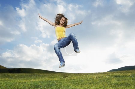 Woman jumping in meadow