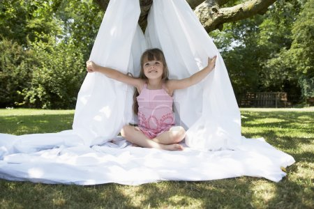 Girl in backyard in tent