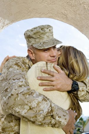 Photo for Young soldier embracing his woman outdoors - Royalty Free Image