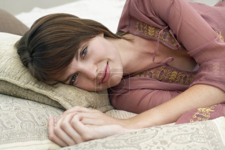 Photo for Woman Laying on Pillows - Royalty Free Image