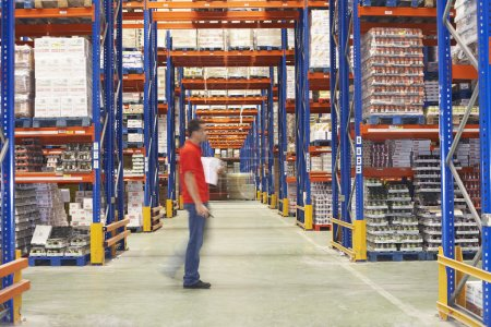 Man Walking Through Warehouse