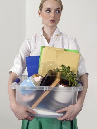 Office worker carrying personal belongings