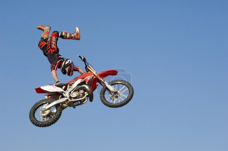 Motocross Racer Performing Stunt