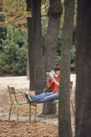 Woman reading book in park