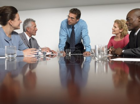 Photo for Multiethnic business people discussing in conference room - Royalty Free Image