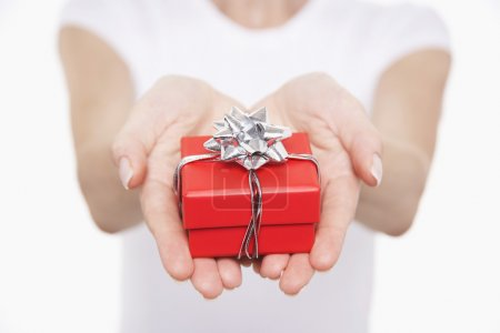 Woman offering small gift
