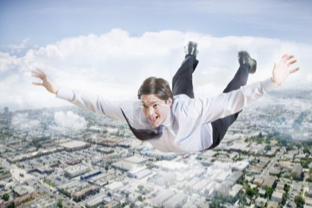 Businessman flying over city
