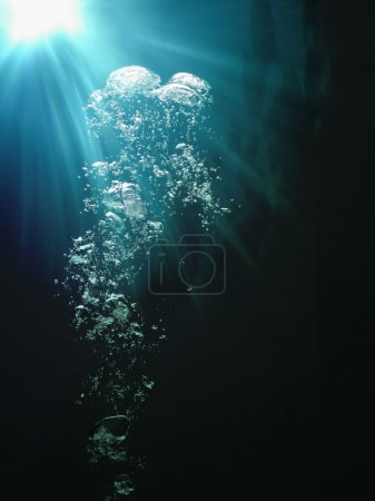 Photo for Underwater bubbles and sunlight breaking through - Royalty Free Image