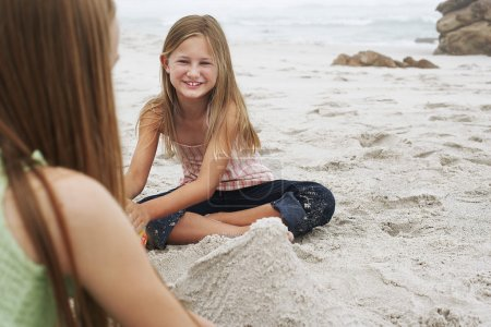 Barefoot girls  on beach