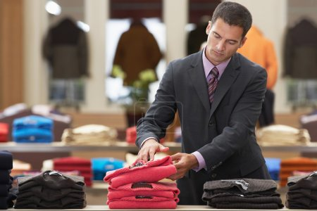 Businessman shopping in clothes store