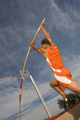 Athlete performing a pole vault