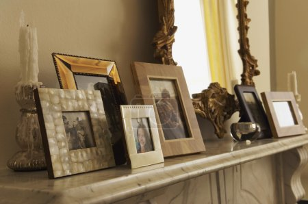 Fireplace Mantel With Framed Pictures